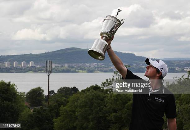 Open winning golfer Rory McIlroy poses with his trophy on a green at Holywood Golf Club on June 22, 2011 in Belfast, Northern Ireland. The 22 year...