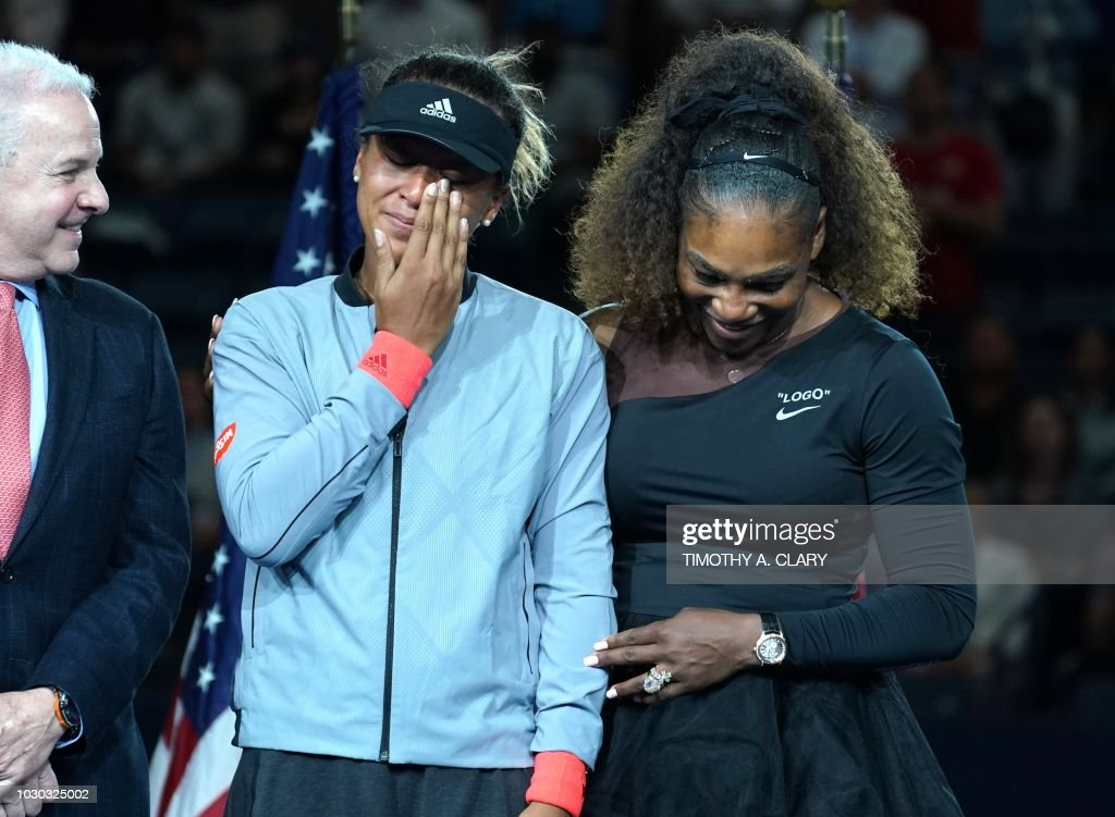 Open Womens Single champion Naomi Osaka of Japan (L) with Serena Williams of the US during their Women's Singles Finals match at the 2018 US Open at the USTA Billie Jean King National Tennis Center in New York on September 8, 2018.