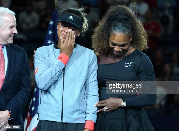 Open Womens Single champion Naomi Osaka of Japan with Serena Williams of the US during their Women's Singles Finals match at the 2018 US Open at the...