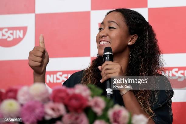 Open Women's Singles champion Naomi Osaka of Japan gestures as she speaks during a press conference on September 13 2018 in Yokohama Kanagawa Japan