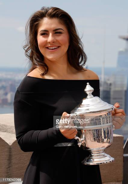 Open women's singles tennis champion Bianca Andreescu of Canada holds her trophy at the Top of the Rock on September 8, 2019 in New York City.