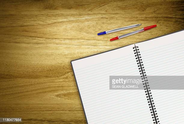 open work book and pens - workbook stock photos and pictures