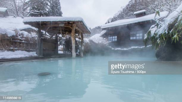 openair bath - hot spring stock pictures, royalty-free photos & images