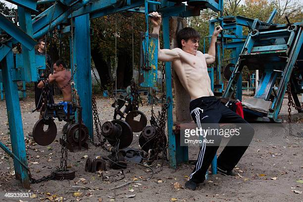 Open-air gym in Hydropark in Kiev with self-made training equipment, and it's frequenters of different age and size.