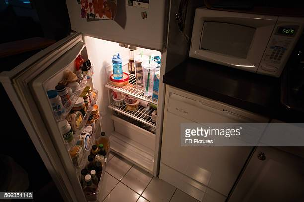 Opened fridge night