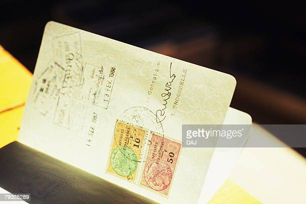 Opened Passport on Table, Close Up, Differential Focus