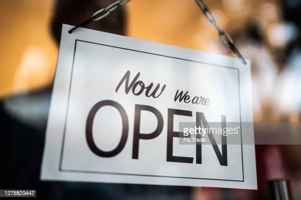 opened sign seen through glass door at store - store opening stock pictures, royalty-free photos & images