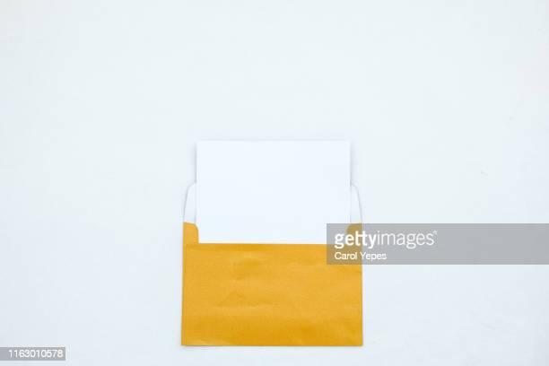 opened white envelope with blank card on white background - responder imagens e fotografias de stock
