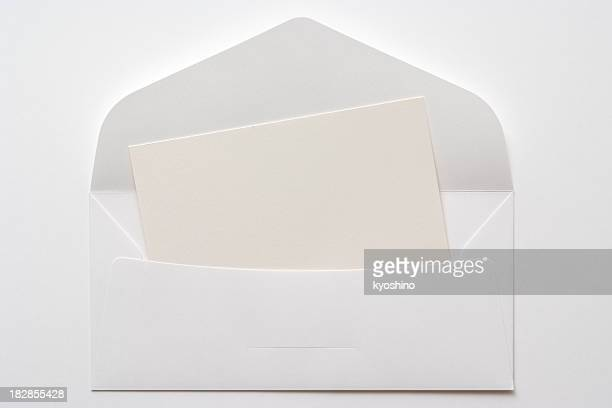 opened white envelope with blank card on white background - bericht stockfoto's en -beelden
