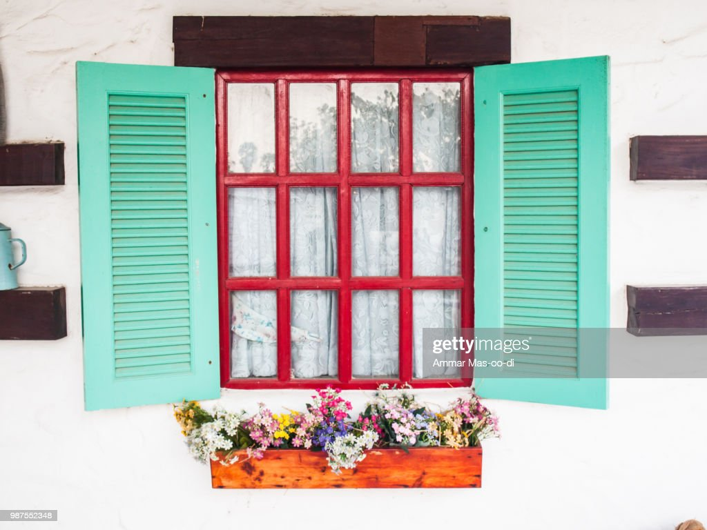 Opened Wooden Shutter Light Green Window On White Wall With