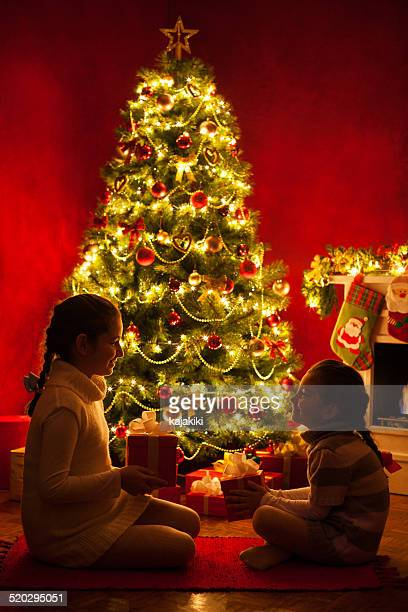opening a christmas presents - 6 11 months stock pictures, royalty-free photos & images