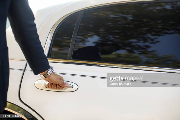 opening a limousine door - limousine stock pictures, royalty-free photos & images