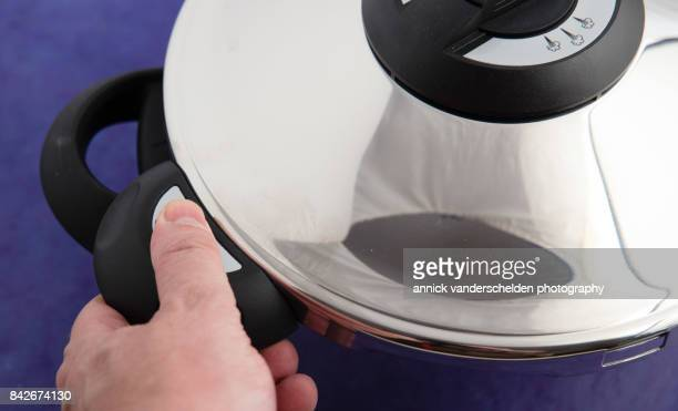 Opening a pressure cooker.