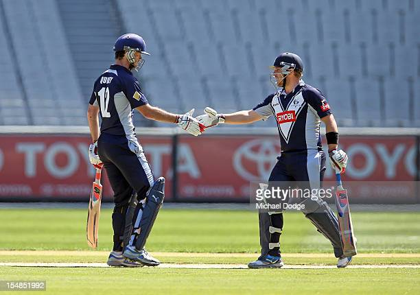 Opening batsmen Rob Quiney left and Aaron Finch of the Bushrangers shake hands after reaching their century partnership during the Ryobi One Day Cup...