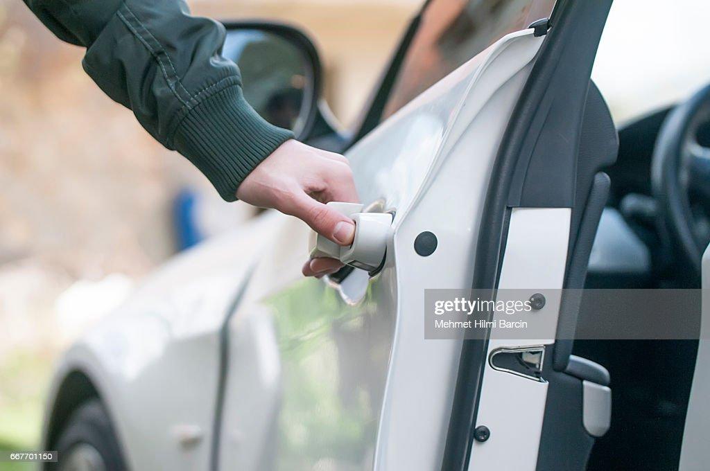 Opening car door : Stock Photo