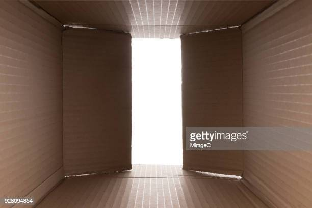 opening cardboard box - carton stock photos and pictures