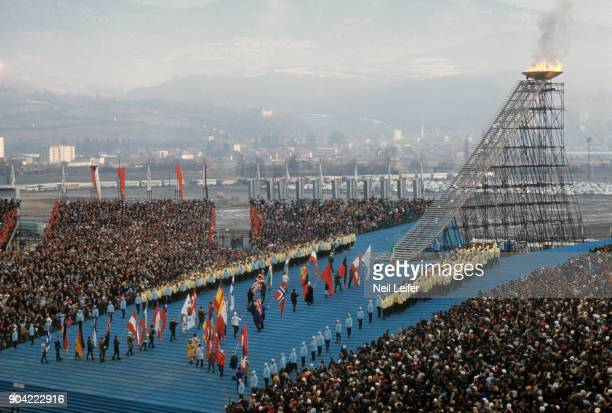1968 Winter Olympics Overvall view of flag bearers during Parade of Nations procession Olympic flame in cauldron Grenoble France 2/6/1968 CREDIT Neil...