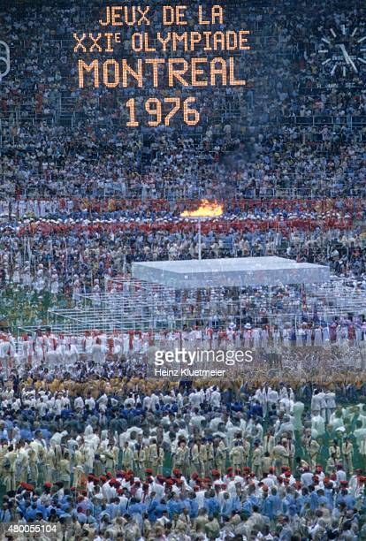 1976 Summer Olympics Double exposure and overall view of Stephane Olympic cauldron with flame during Parade of Nations at Olympic Stadium Montreal...