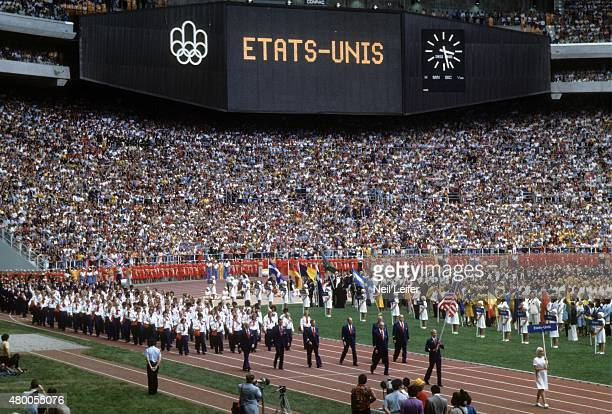 1976 Summer Olympics Overall view of Team USA swimming medalist and national flag bearer USA Gary Hall leads team during Parade of Nations at Olympic...