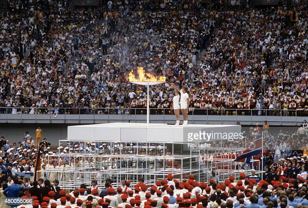1976 Summer Olympics View of Stephane Prefontaine and Sandra Henderson lighting Olympic cauldron with torch flame at Olympic Stadium Montreal Canada...