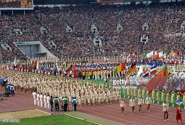 1980 Summer Olympics View of USSR flag bearer and wrestler Nikolay Balboshin and team delegation during parade of nations at Central Lenin Stadium...