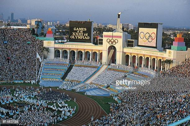 Opening Ceremony 1984 Summer Olympics Overall view of USA Rafer Johnson lighting torch at Memorial Coliseum Los Angeles CA 7/28/1984
