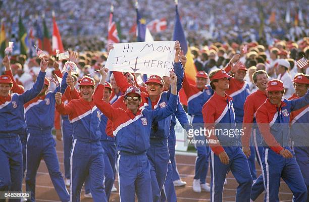 1984 Summer Olympics Team USA athlete with HI MOM I'M HERE sign delegation during procession at Memorial Coliseum Los Angeles CA 7/28/1984 CREDIT...