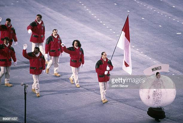 1992 Winter Olympics Team Monaco flag bearer Albert II Hereditary Prince of Monaco leading delegation during athlete procession at Theatre des...