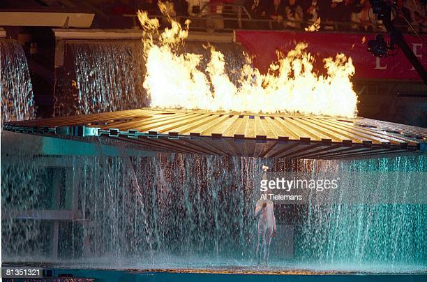 Opening Ceremony 2000 Summer Olympics Australia track field athlete Cathy Freeman with torch lighting flame at Olympic Stadium Sydney AUS 9/15/2000