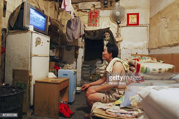 2008 Summer Olympics Chinese citizen watching opening performance on television in historic hutong alley neighborhood Beijing China 8/8/2008 CREDIT...