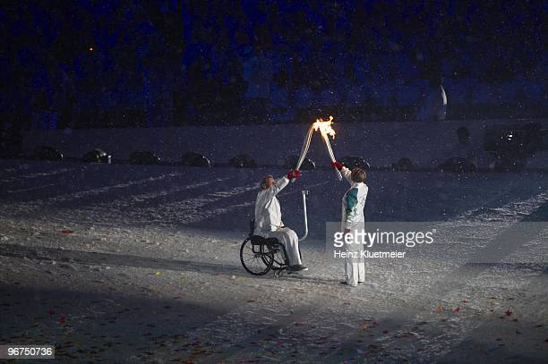 2010 Winter Olympics Canadian paraplegic athlete Rick Hansen and former speed skating athlete Catriona Le May Doan with Olympic Flame during torch...