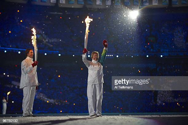 Winter Olympics: View of NBA player Steve Nash and former Canadian alpine skiing athlete Nancy Greene with Olympic Flame during torch lighting at BC...