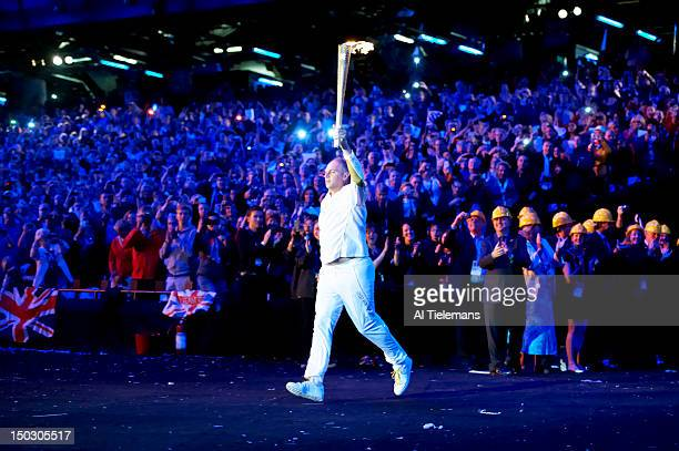 2012 Summer Olympics Former Great Britain Olympic rowing medalist Steve Redgrave holding Olympic torch at Olympic Stadium London United Kingdom...