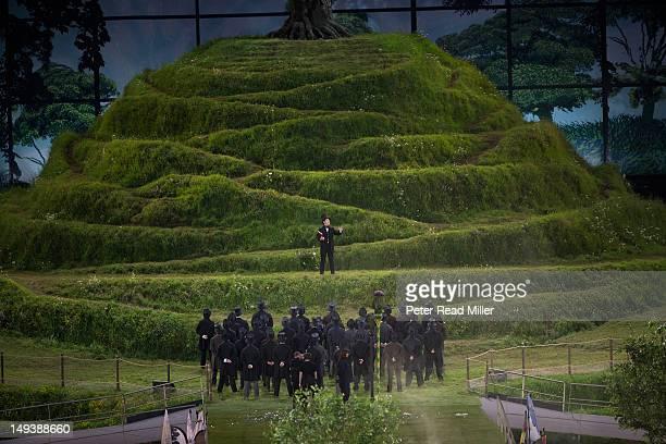 2012 Summer Olympics Northern Ireland celebrity actor Kenneth Branagh performing on model of Glastonbury Tor at Olympic Stadium London United Kingdom...