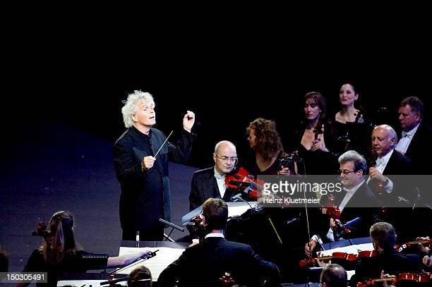 2012 Summer Olympics View of Simon Rattle conducting the London Symphony Orchestra at Olympic Stadium London United Kingdom 7/27/2012 CREDIT Heinz...