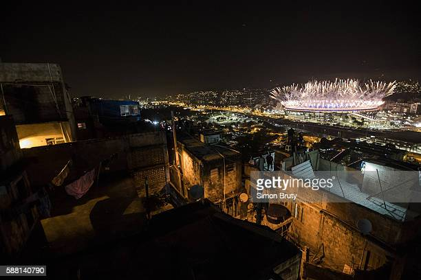 2016 Summer Olympics Scenic view from rooftop in the Mangueira favela of fireworks during ceremonies at Maracana Stadium Rio de Janeiro Brazil...