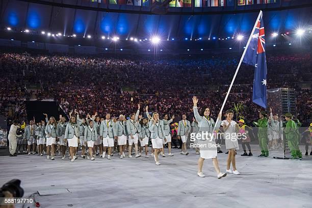 2016 Summer Olympics Team Australia cycler and national flag bearer Anna Meares leads team during Parade of Nations at Maracana Stadium Rio de...