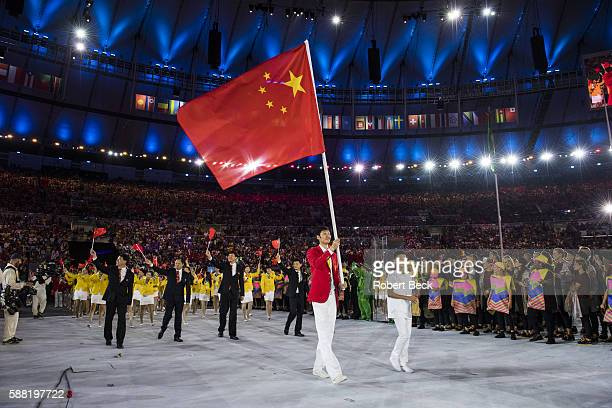 2016 Summer Olympics Team China fencer and national flag bearer Lei Sheng leads team during Parade of Nations at Maracana Stadium Rio de Janeiro...