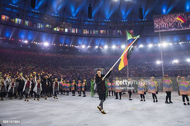 2016 Summer Olympics Team Germany table tennis player and national flag bearer Timo Boll leads team during Parade of Nations at Maracana Stadium Rio...