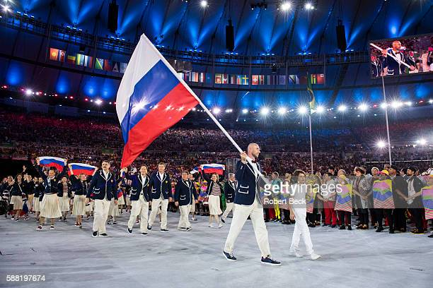 2016 Summer Olympics Team Russia volleyball player and national flag bearer Sergey Tetyukhin leads team during Parade of Nations at Maracana Stadium...