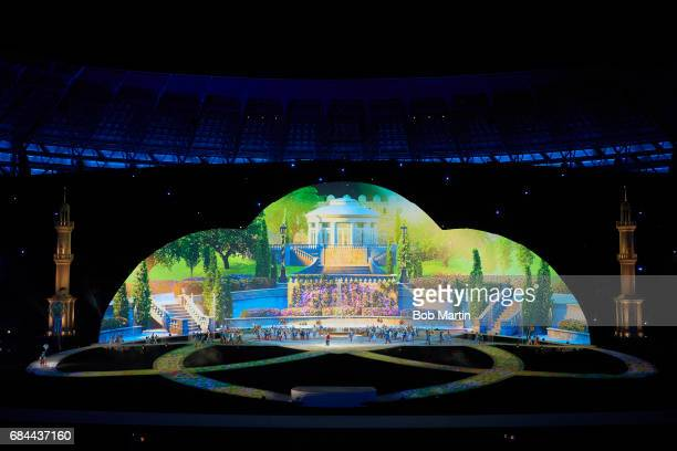 4th Islamic Solidarity Games: Overall view of performers dancing in front of a set of the Hanging Gardens of Babylon during ceremonies at Baku...