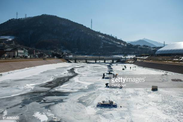 Opening ceremony fireworks are prepared on a frozen river next to the Olympic stadium ahead of the 2018 Winter Olympics on February 4 2018 in...