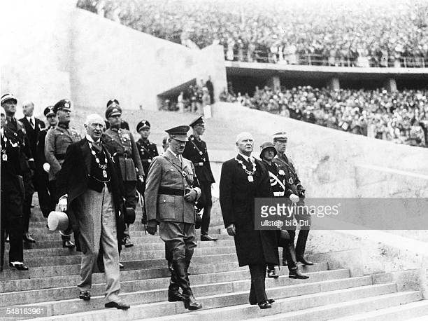 Opening ceremony of the 1936 Summer Olympics in Berlin: Adolf Hitler, members of the IOC and of the German organizing committee enter the Olympic...