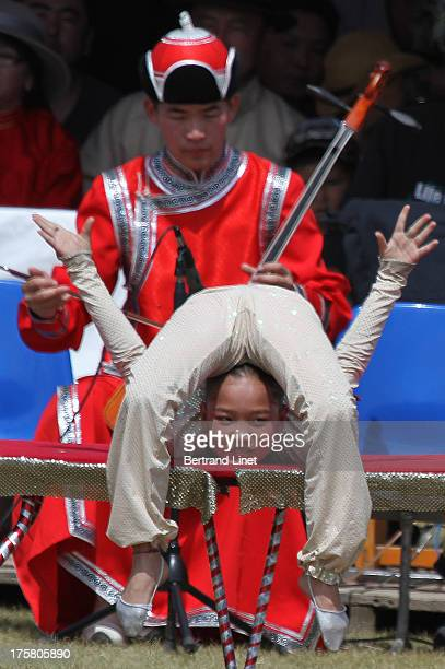 CONTENT] Opening ceremony of the Naadam festival in Kharkhorin with a mongolian contortionist The Naadam is a traditional type of festival in...