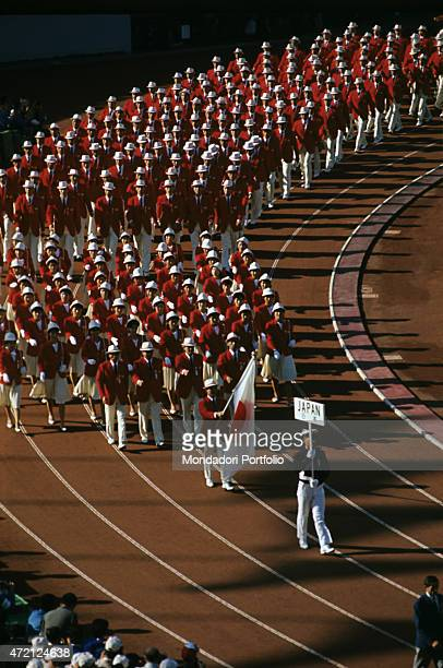 Opening ceremony of the XVIII Olympics in the Tokyo National Stadium the national Japanese team athletes march on the athletics track in an orderly...