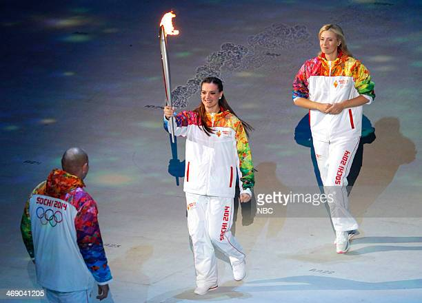 GAMES 'Opening Ceremony' Pictured Torchbearers Alexander Karelin Elena Isinbaeva Maria Sharapova during the opening ceremony of the 2014 Sochi Winter...