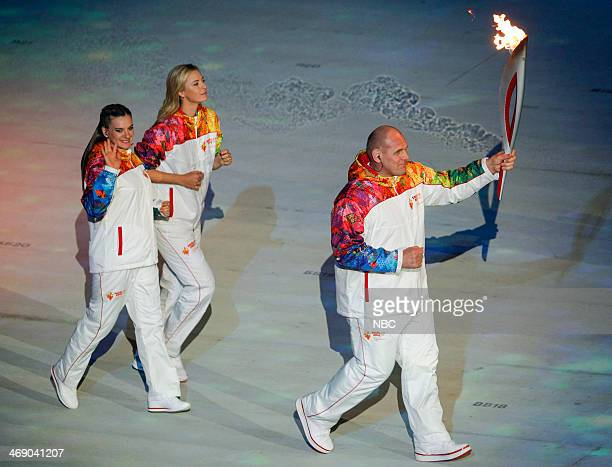 GAMES 'Opening Ceremony' Pictured Torchbearers Elena Isinbaeva Maria Sharapova Alexander Karelin during the opening ceremony of the 2014 Sochi Winter...