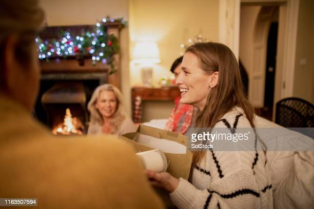 opening christmas gifts - novelty item stock pictures, royalty-free photos & images