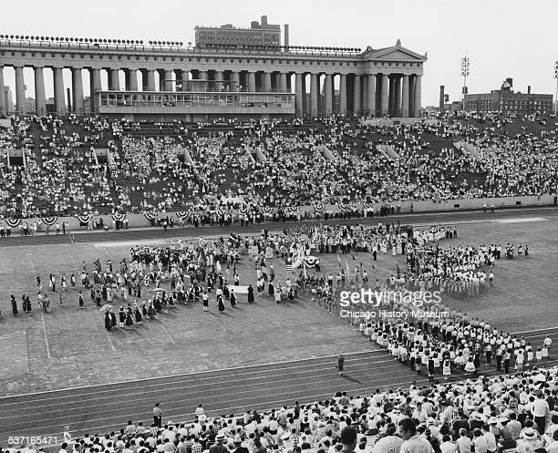 Opening day ceremonies of the Pan American Games at Soldier Field Chicago Illinois August 27 1959 Participants dressed in garb representing different...