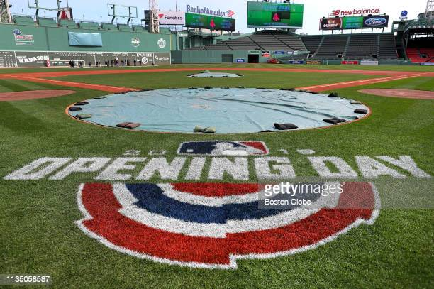 Opening Day logo is seen on the field as Fenway Park in Boston undergoes lastminute preparations for the upcoming Boston Red Sox home opener on April...